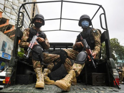 Paramilitary soldiers patrol near the Pakistan Stock Exchange building following an attack by gunmen in Karachi on June 29, 2020. - At least six people were killed when gunmen attacked the Pakistan Stock Exchange in Karachi on June 9, with a policeman among the dead after the assailants opened fire …