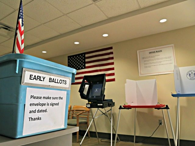 FILE - In this March 21, 2016 file photo, an example of an early ballot collection box and demonstration of voting areas is set up ahead of the state's Presidential Primary Election at the Maricopa County Recorder's office in Phoenix. Lawyers representing state and national Democrat opposed to a new …