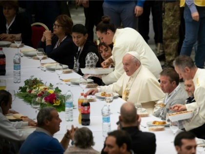 Pope Francis sits at a table during a lunch, in the Paul VI Hall at the Vatican, Sunday, Nov. 17, 2019. Pope Francis is offering several hundred poor people, homeless, migrants, unemployed, a lunch on Sunday as he celebrates the World Day of the Poor with a concrete gesture of …