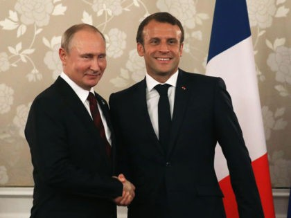 France's President Emmanuel Macron (R) shakes hands with Russia's President Vladimir Putin during a bilateral meeting on the sidelines of the G20 Summit in Osaka on June 28, 2019. (Photo by LUDOVIC MARIN / AFP) (Photo credit should read LUDOVIC MARIN/AFP via Getty Images)