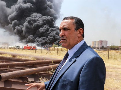 Kirkuk Governor Rakan Said al-Juburi looks on as he stands away from a plume of smoke billowing from a fire that broke out at the North Oil Company installations in the disputed oil-rich province of Kirkuk, north of Iraqi capital Baghdad, on August 29, 2019. The exact cause of the …