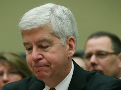 Gov. Rick Snyder, (R-MI), listens to members comments during a House Oversight and Government Reform Committee hearing, about the Flint, Michigan water crisis, on Capitol Hill March 17, 2016 in Washington, DC. The committee is examining how lead ended up in the public drinking water in Flint, Michigan. (Photo by …