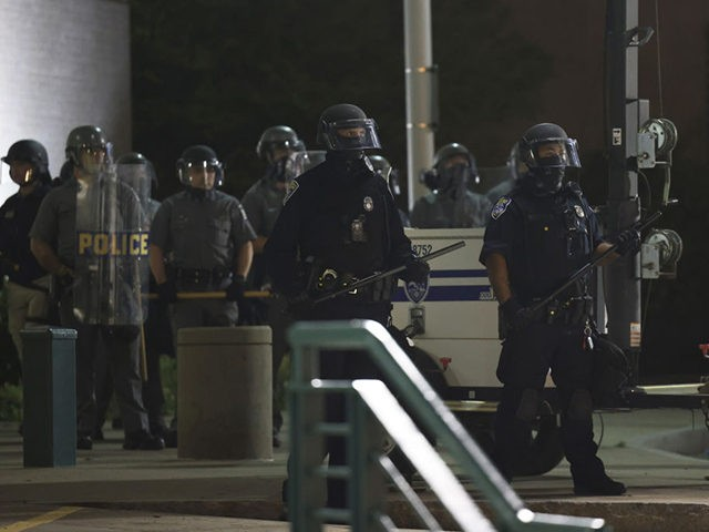 ROCHESTER, NEW YORK - SEPTEMBER 07: Police officers stand in formation during a standoff with demonstrators in front of the Public Safety Building after a peaceful march for Daniel Prude on September 07, 2020 in Rochester, New York. This is the sixth consecutive night of protesting since the family released …