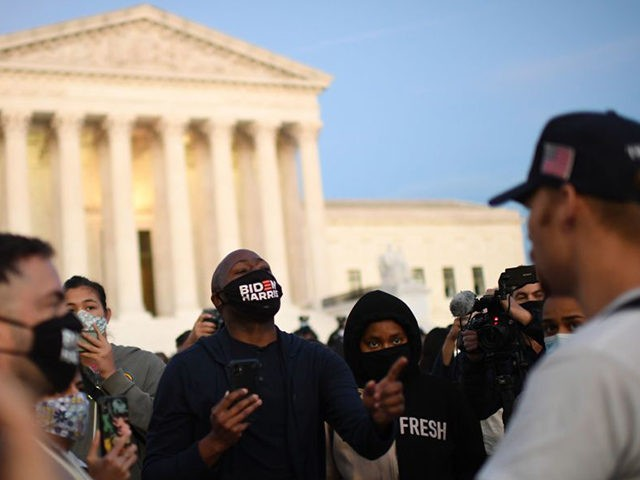 People paying respects to Ruth Bader Ginsburg argue with anti-abortion protests near the US Supreme Court in Washington, DC on September 19, 2020. - US President Donald Trump vowed to quickly nominate a successor, likely a woman, to replace late Supreme Court Justice Ruth Bader Ginsburg, only a day after …