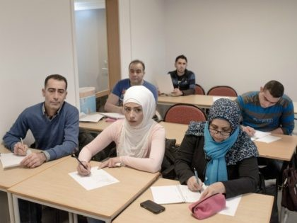 HALMSTAD, SWEDEN - FEBRUARY 08: Asylum seekers from Syria and Irak attend a Swedish language class at the Halmstad University on February 8, 2016 in Halmstad, Sweden. Last year Sweden received 162,877 asylum applications, more than any European country proportionate to its population. According to the Swedish Migration Agency, Sweden …