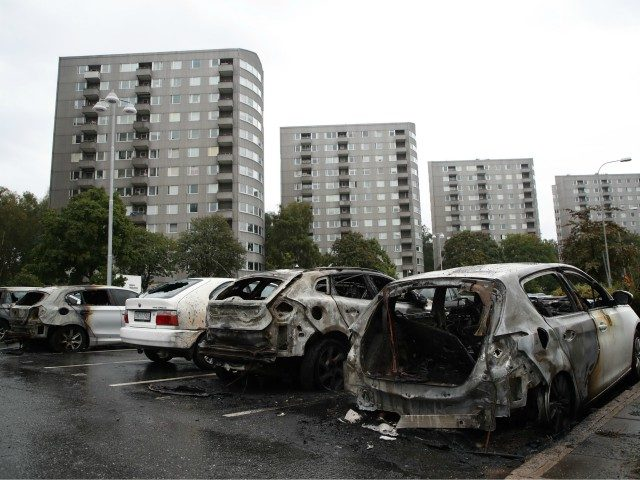 Burned cars are pictured at Froelunda Square in Gothenburg, Sweden on August 14, 2018. - Up to 80 cars have been set on fire in western Sweden by masked vandals, police said on August 14, 2018, in what was described as organised crime weeks before the general election. Most of …