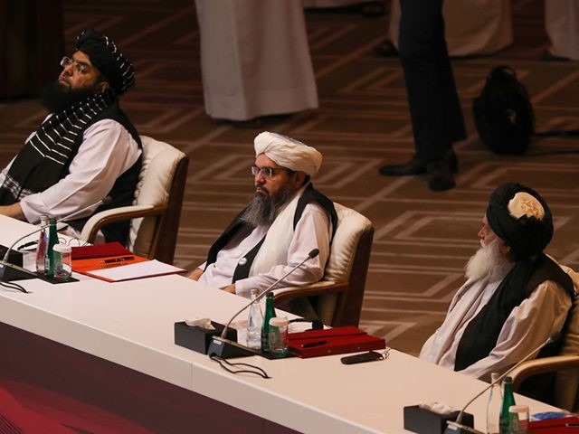 Members of the Taliban delegation attend the opening session of the peace talks between the Afghan government and the Taliban in the Qatari capital Doha on September 12, 2020. (Photo by KARIM JAAFAR / AFP) (Photo by KARIM JAAFAR/AFP via Getty Images)