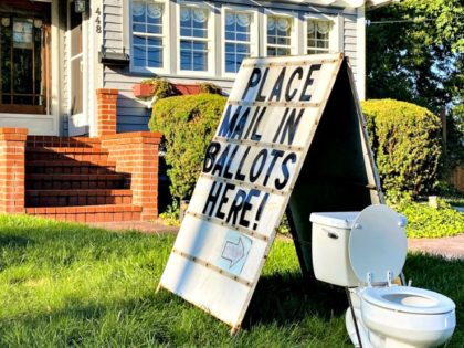 A political display is set up in the lawn of a home on West Columbia Street in Mason, Mich., on Friday, Sept. 18, 2020. (Matthew Dae Smith/Lansing State Journal via AP)