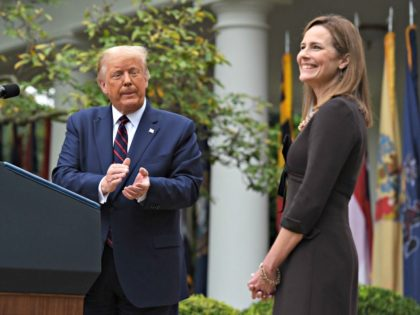 US President Donald Trump announces his US Supreme Court nominee, Judge Amy Coney Barrett (R), in the Rose Garden of the White House in Washington, DC on September 26, 2020. - Barrett, if confirmed by the US Senate, will replace Justice Ruth Bader Ginsburg, who died on September 18. (Photo …