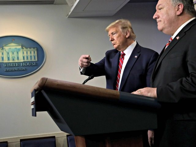 WASHINGTON, DC - MARCH 20: U.S. President Donald Trump directs questions to Secretary of State Mike Pompeo during a news briefing on the latest development of the coronavirus outbreak in the U.S. at the James Brady Press Briefing Room at the White House March 20, 2020 in Washington, DC. With …