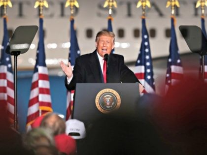 MOSINEE, WISCONSIN - SEPTEMBER 17: US President Donald Trump speaks to supporters during a rally at Central Wisconsin Airport on September 17, 2020 in Mosinee, Wisconsin. According to recent polls, former Vice President Joe Biden has a slight lead over Trump in the state. Trump is expected to campaign in …
