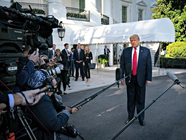 WASHINGTON, DC - SEPTEMBER 19: U.S. President Donald Trump speaks to members of the press prior to his departure from the White House on September 19, 2020 in Washington, DC. President Trump is traveling to North Carolina for a campaign rally. (Photo by Sarah Silbiger/Getty Images)