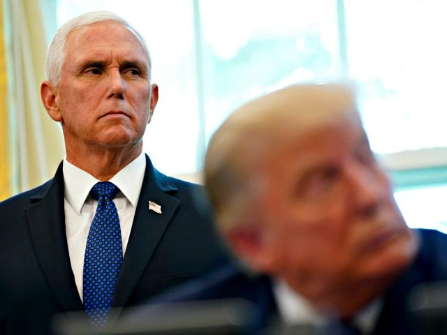 President Donald Trump and Vice President Mike Pence listen during an announcement in the Oval Office of the White House on Friday, Sept. 11, 2020, in Washington. Bahrain has become the latest Arab nation to agree to normalize ties with Israel as part of a broader diplomatic push by Trump …