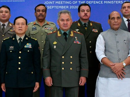 China's Minister of National Defence Wei Fenghe, left, Russian Defense Minister Sergei Shoigu, center, and Indian Defense Minister, Rajnath Singh, right, pose for a photo with their colleagues at a Joint Meeting of Defense Ministers of Shanghai Cooperation Organisation, Commonwealth of Independent States and Collective Security Treaty Organization Member States …
