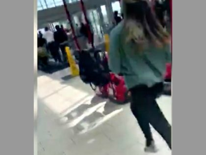 Woman Running from Mall Shooting