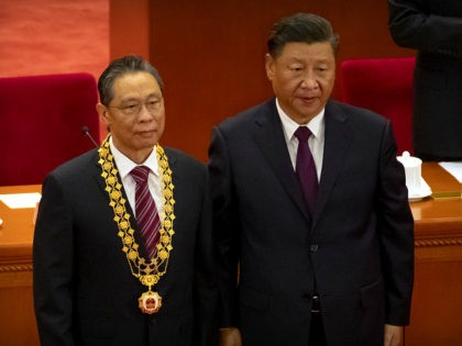 Chinese President Xi Jinping, right, stands with Chinese medical expert Zhong Nanshan after awarding him a medal at an event to honor some of those involved in China's fight against COVID-19 at the Great Hall of the People in Beijing, Tuesday, Sept. 8, 2020. Chinese leader Xi Jinping is praising …