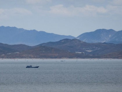 This photo taken on April 24, 2018 shows a general view of unidentified fishing boats before the North Korean coastline from a viewpoint on the South Korea-controlled island of Yeonpyeong near the disputed waters of the Yellow Sea at dawn. - North Korean forces shot dead a Southern fisheries official …