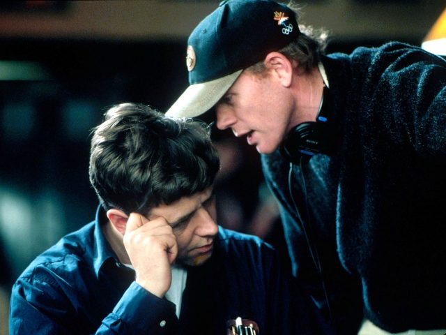 """401864 09: (EDITORIAL USE ONLY, COPYRIGHT MCA/UNIVERSAL PICTURES) Director Ron Howard speaks with actor Russell Crowe on the set of the film """"A Beautiful Mind."""" (Photo by MCA/Universal Pictures/Getty Images)"""