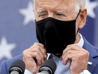 WARREN, MICHIGAN - SEPTEMBER 09: Democratic presidential nominee and former Vice President Joe Biden replaces the mask he wears to reduce the risk posed by coronavirus after addressing union members outside the United Auto Workers Region 1 offices September 09, 2020 in Warren, Michigan. Biden is campaigning in Michigan, a …