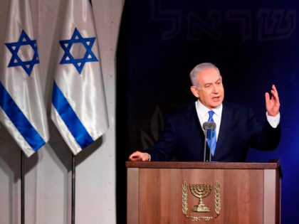 Israeli Prime Minister Benjamin Netanyahu speaks during a handover ceremony for the new Israeli chief of staff on January 15, 2019 at the Defence Ministry in Tel Aviv. - Iran launched a satellite criticised by the United States as a breach of a UN resolution today but it failed to …