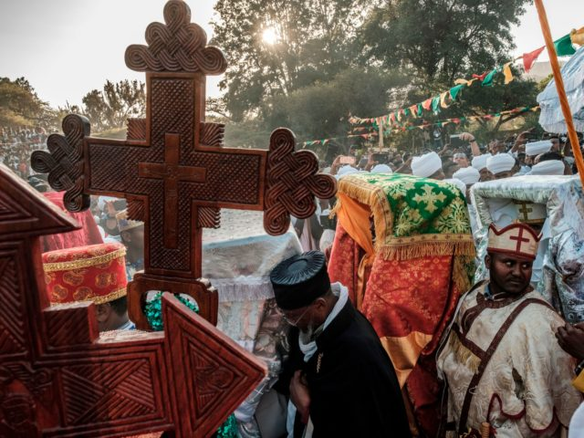 Ethiopian Orthodox Christians take part in the celebration of Timkat, the Ethiopian Epiphany, in Gondar, on January 19, 2020. - Timkat is the Ethiopian Orthodox Christian festival which celebrates the baptism of Jesus in the Jordan river. (Photo by EDUARDO SOTERAS / AFP) (Photo by EDUARDO SOTERAS/AFP via Getty Images)