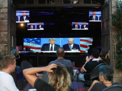 WEST HOLLYWOOD, CALIFORNIA - SEPTEMBER 29: People sit and watch a broadcast of the first debate between President Donald Trump and Democratic presidential nominee Joe Biden at The Abbey, with socially distanced outdoor seating, on September 29, 2020 in West Hollywood, California. The debate being held in Cleveland, Ohio is …