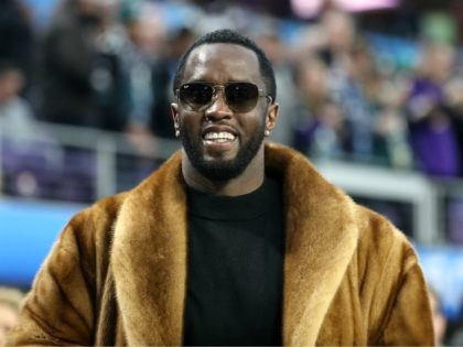 """MINNEAPOLIS, MN - FEBRUARY 04: Rapper Sean """"Diddy"""" Combs looks on during warm-ups prior to Super Bowl LII between the New England Patriots and the Philadelphia Eagles at U.S. Bank Stadium on February 4, 2018 in Minneapolis, Minnesota. (Photo by Rob Carr/Getty Images)"""