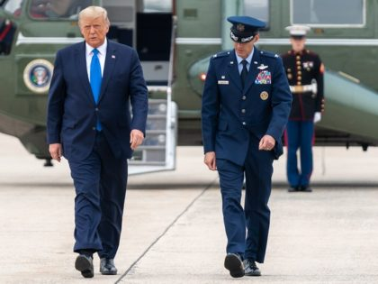 President Donald J. Trump disembarks Marine One at Joint Base Andrews, Md. Thursday, Sept. 24, 2020, and is escorted to Air Force One by U.S. Air Force Col. Stephen Snelson, Commander of the 89th Airlift Wing at Joint Base Andrews. (Official White House Photo by Shealah Craighead)