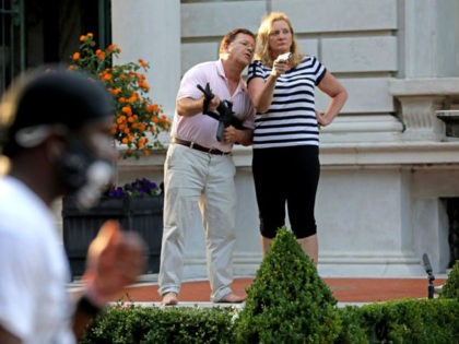 In this June 28, 2020 file photo, Mark and Patricia McCloskey emerged from their St. Louis mansion with guns after protesters walked onto their private street. The couple, who were criminally charged for the incident, will make the case in a recorded message Monday night, Aug. 24 in their opening …