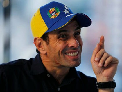 FILE - In this Feb. 25, 2014 file photo, opposition leader Henrique Capriles points during an interview at his office in Caracas, Venezuela. Capriles is routinely denounced, with little direct evidence, as a sellout who has cut secret deals to coexist with Venezuelan President Nicolas Maduro. He has recently hinted …