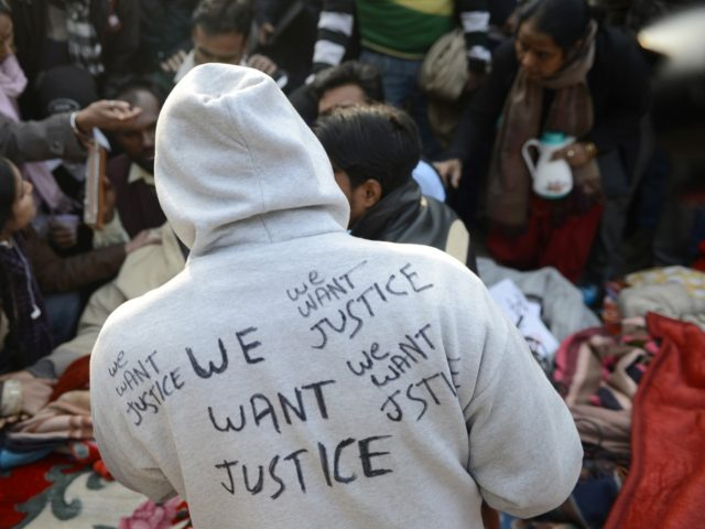 Gang Rape An Indian protester wears a jacket with slogans at Jantar Mantar during a protest against a gang rape in New Delhi on January 6, 2013. Claims of police incompetence and public apathy stirred new anger in the Delhi gang-rape case after the boyfriend of the victim recounted details …