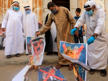Israel-Bahrain Deal Palestinian men burn the exed out portraits of the Bahraini King, US President and Israeli Premier during a protest in Deir al-Balah, in central Gaza Strip, on September 12, 2020, to condemn the normalisation of ties between Israeli and Bahrain. - The Palestinian cause has long cemented ties …