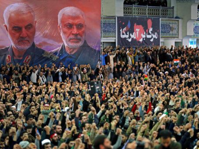 In this picture released by the official website of the office of the Iranian supreme leader, worshippers chant slogans during Friday prayers ceremony, as a banner show Iranian Revolutionary Guard Gen. Qassem Soleimani, left, and Iraqi Shiite senior militia commander Abu Mahdi al-Muhandis, who were killed in Iraq in a …