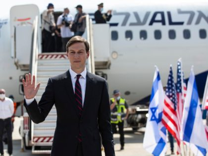 U.S. President Donald Trump's senior adviser and son-in-law Jared Kushner, center, waves while standing with national security adviser Robert O'Brien before their departure to Abu Dhabi, at Ben-Gurion Airport, in Lod, near Tel Aviv, Israel, Monday, Aug. 31, 2020. (Heidi Levine/Pool via AP).