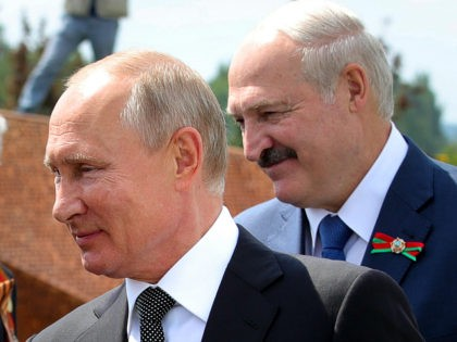 FILE - In this June 30, 2020, file photo, Russian President Vladimir Putin, left, and Belarusian President Alexander Lukashenko greet World War II veterans during the opening of a monument in their honor in the village of Khoroshevo, northwest of Moscow, Russia. Lukashenko is beset by protests since his Aug. …