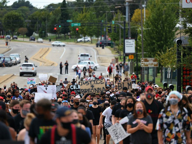 LOUISVILLE, KENTUCKY - SEPTEMBER 25: People participate in a march lead by the University of Louisville's Men's basketball team calling for justice for Breonna Taylor on September 25, 2020 in Louisville, Kentucky. A Kentucky grand jury indicted one police officer involved in the shooting of Breonna Taylor with three counts …