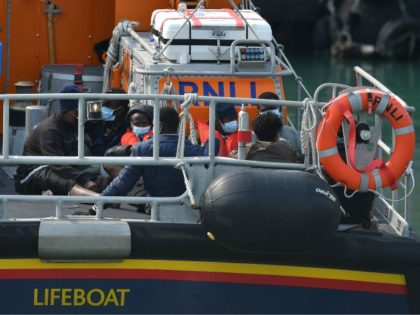 Migrants picked up at sea whilst crossing the English Channel are brought into the Marina in Dover, southeast England on September 11, 2020 on an RNLI lifeboat. - Nearly 1,500 migrants and asylum-seekers arrived in Britain by small boats in the month of August, according to an analysis by the …
