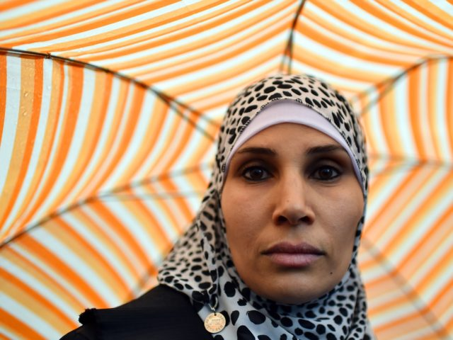 A woman looks on during a demonstration of muslims to speak out against terrorism a week after Paris attacks, on November 21, 2015 in Rome. Hundreds of Muslims rallied in Rome and Milan on Saturday to show solidarity with the victims of jihadist attacks, condemning violence in the name of …