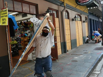 NEW ORLEANS, LOUISIANA - SEPTEMBER 14: Luis A. Sanabria puts plywood over the windows of a business in the historic French Quarter before the possible arrival of Hurricane Sally on September 14, 2020 in New Orleans, Louisiana. The storm is threatening to bring heavy rain, high winds and a dangerous …