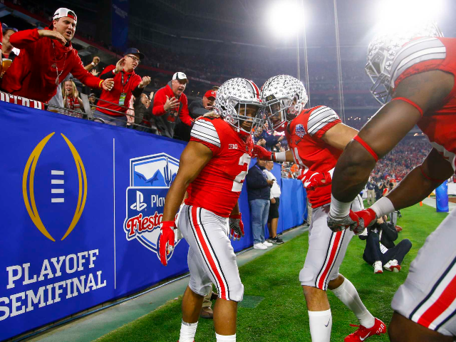 In this Dec. 28, 2019, file photo, Ohio State running back J.K. Dobbins, left, celebrates his touchdown with wide receiver Austin Mack during the first half of the team's Fiesta Bowl NCAA college football playoff semifinal against Clemson, in Glendale, Ariz. Clemson is preseason No. 1 in The Associated Press …