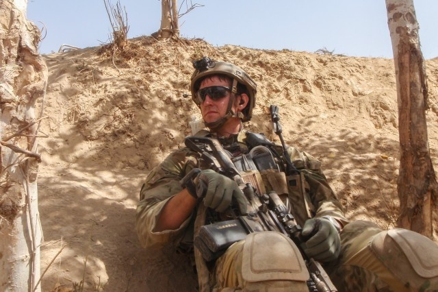 "Sgt. Maj. Thomas ""Patrick"" Payne conducting a security patrol while on a mission in northern Afghanistan in 2014. (Photo Credit: Courtesy photo )"
