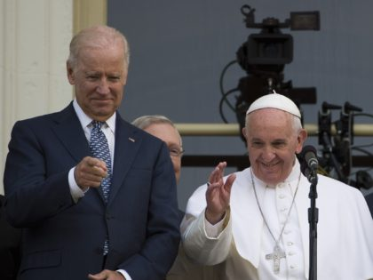Pope Francis waves, next to US Vice President Joe Biden, on a balcony after speaking at the US Capitol building in Washington, DC on September 24, 2015. AFP PHOTO/ ANDREW CABALLERO-REYNOLDS (Photo credit should read Andrew Caballero-Reynolds/AFP via Getty Images)