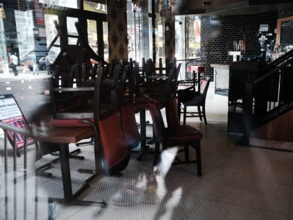 NEW YORK, NEW YORK - AUGUST 31: Chairs are piled-up inside of a closed restaurant in Manhattan on August 31, 2020 in New York City. While New York City restaurants are currently permitted to serve take-out and to offer sidewalk dining, they are not allowed to offer indoor dining due …
