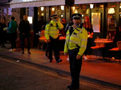 Police patrol in Soho, in central London on September 24, 2020, on the first day of the new earlier closing times for pubs and bars in England and Wales, introduced to combat the spread of the coronavirus. - Britain has tightened restrictions to stem a surge of coronavirus cases, ordering …