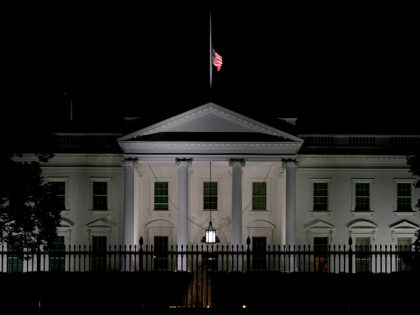 The US flag flies at half-mast above the White House in Washington, DC, late on September 18, 2020 after the passing of US Supreme Court Justice Ruth Bader Ginsburg. - Progressive icon and doyenne of the US Supreme Court, Ruth Bader Ginsburg, has died at the age of 87 after …
