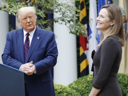 US President Donald J. Trump introduces Judge Amy Coney Barrett (R) as his nominee to be an Associate Justice of the Supreme Court during a ceremony in the Rose Garden of the White House in Washington, DC, on Saturday, September 26, 2020. Judge Barrett, if confirmed, will replace the late …