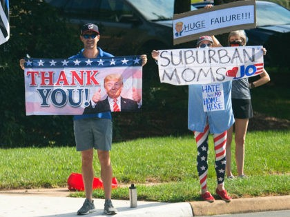 Supporters of US President Donald Trump and of Democratic presidential nominee former Vice President Joe Biden hold signs as Trump's motorcade arrives at Trump National Golf Club in Sterling, Virginia, August 23, 2020. (Photo by SAUL LOEB / AFP) (Photo by SAUL LOEB/AFP via Getty Images)