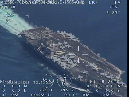 This photo released by the official website of the Iranian Revolutionary Guard on Wednesday, Sept. 23, 2020 is said to show the USS Nimitz Aircraft carrier prior to entering the strategic Strait of Hormuz and Persian Gulf. Iran's powerful Revolutionary Guard force has managed to fly a surveillance drone over …