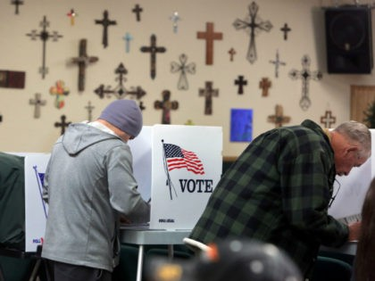 People vote at a polling station in the Summit Christian Fellowship in Big Bear, California, November 8, 2016. / AFP / Bill Wechter (Photo credit should read BILL WECHTER/AFP via Getty Images)