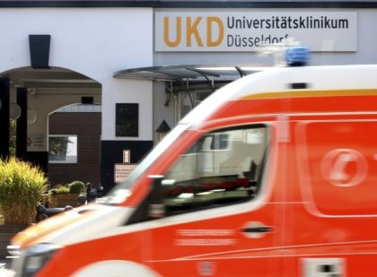 An ambulance drives past the University Hospital in Duesseldorf, Germany, Tuesday, Sept. 15, 2020. German authorities say a hacker attack caused the partial failure of IT systems at a major hospital in Duesseldorf, and a woman who needed urgent admission died after she had to be taken to another city …